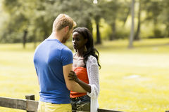 Loving couple by tge fence Stock Images