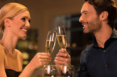 Loving couple toasting Stock Images