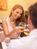 Loving couple toasting a restaurant Royalty Free Stock Images