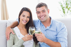 Loving couple toasting wine glasses at home Royalty Free Stock Image