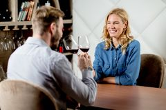 Couple toasting wineglasses in a luxury restaurant stock photos