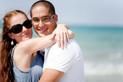 Loving couple together at the beach Stock Photography