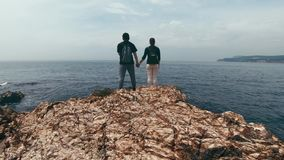 A loving couple of tourists stands on the beach in Turkey and enjoy a very beautiful view stock footage