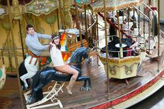 Couple on a Parisian merry-go-round Stock Image