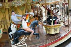 Couple on a Parisian merry-go-round Stock Image