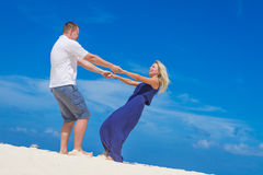 Loving couple on tropical beach background Stock Photography