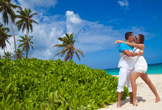 Loving couple on tropical beach Stock Photography