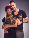 Loving couple with two yorkshire terrier dogs Stock Photo