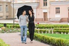 Loving couple with umbrella. Royalty Free Stock Image