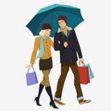 Loving couple under an umbrella Stock Image