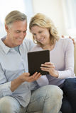 Loving Couple Using Digital Tablet At Home Royalty Free Stock Photo