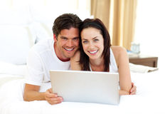Loving couple using laptop Royalty Free Stock Photography