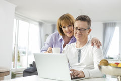 Loving couple using laptop together at home Royalty Free Stock Photography