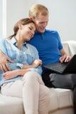 Loving couple using laptop Stock Images