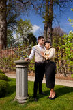 Loving couple in Victorian clothing, column and su Stock Image