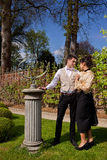 Loving couple in Victorian clothing, pillar and su Royalty Free Stock Photography