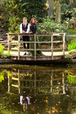 Loving couple in Victorian fashion near lake with reflections  in park Stock Image