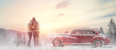 Loving couple and vintage car Stock Images