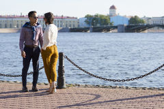 The loving couple walk on embankment of a river `Neva`. Royalty Free Stock Photography