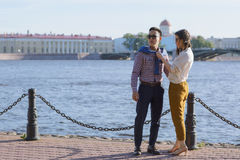 The loving couple walk on embankment of a river `Neva`. Royalty Free Stock Images