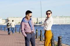 The loving couple walk on embankment of a river `Neva`. Stock Images