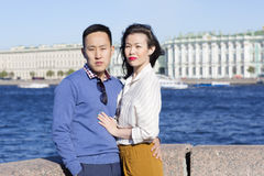 The loving couple walk on embankment of a river `Neva`. Stock Photo