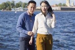 The loving couple walk on embankment of a river `Neva`. Royalty Free Stock Image