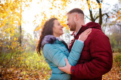 Loving couple walking in the autumn forest and hugging Stock Photo
