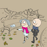 Loving couple walking in autumn park. Boy and girl walking in autumn park Stock Images
