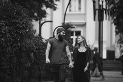 Loving couple walking through the city Stock Image