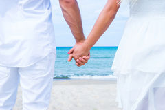 Loving couple walking and embracing on the beach Stock Photos