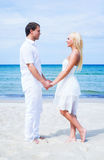 Loving couple walking and embracing on a summer beach Royalty Free Stock Images