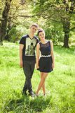 Loving couple walking on grass at park Royalty Free Stock Images