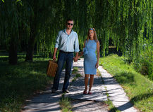 Loving couple walking hand-in-hand stock images