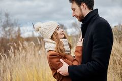 Loving couple walking in Park in autumn hugs and kisses. Autumn Stock Photos