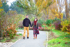 Loving couple walking in the park Royalty Free Stock Photography