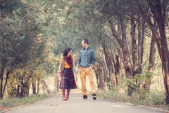 Loving couple walking in the park Stock Photo