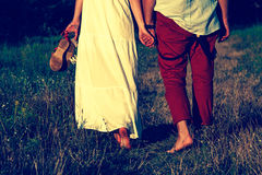 Loving couple walking in the park. Couple walking in summer landscape Royalty Free Stock Photo