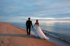 A loving couple walking by the sea coast Royalty Free Stock Image
