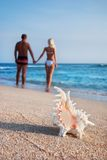 Loving couple walking on the sea sand beach Stock Photo