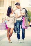 Loving Couple Walking After Shopping Stock Photo