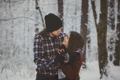 Loving couple in snowy winter forest Royalty Free Stock Photo