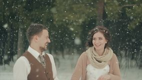 Loving couple walking in winter christmas park. The snowfall stock footage