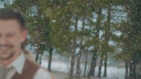 Loving couple walking in winter christmas park. snowfall stock video footage