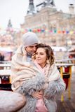 Embracing man and woman winter outside. New year street decoration stock photo