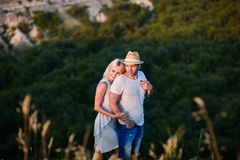 Happy couple in a field of lavender. A loving couple walks in the field of lavender, dreams and smiles. They are happy together and love each other royalty free stock photos