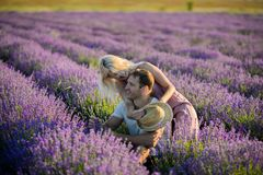 Happy couple in a field of lavender stock photo