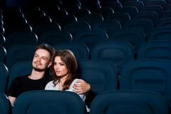 Loving couple watching a movie in the empty cinema Royalty Free Stock Images