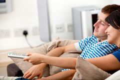 Loving couple watching tv Stock Photos