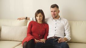 Loving couple watching TV. And smiling in hotel room stock video footage